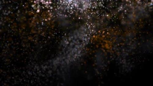 Fallen glitzernde Partikel