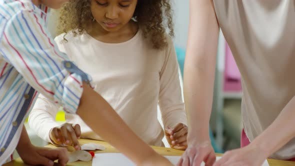 Thumbnail for Little Diverse Kids Making Paper Craft with Female Teacher