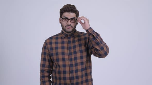 Cover Image for Young Bearded Indian Hipster Man Thinking
