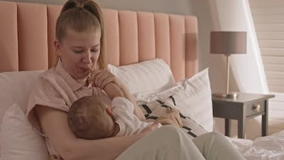 Young Woman Breastfeeding Child