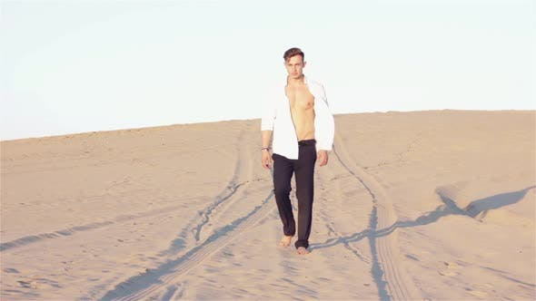Thumbnail for Sexy Man is Walking in Desert