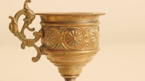 Hand made brass holy grail style high detailed 4K 2160p UltraHD tilting footage - Slow tilt on holy