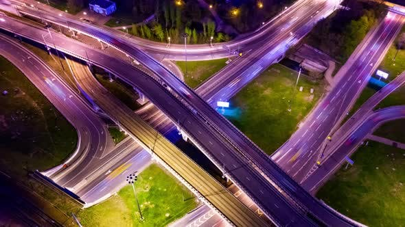Cover Image for Freeway Intersection Traffic Trails in Night Moscow