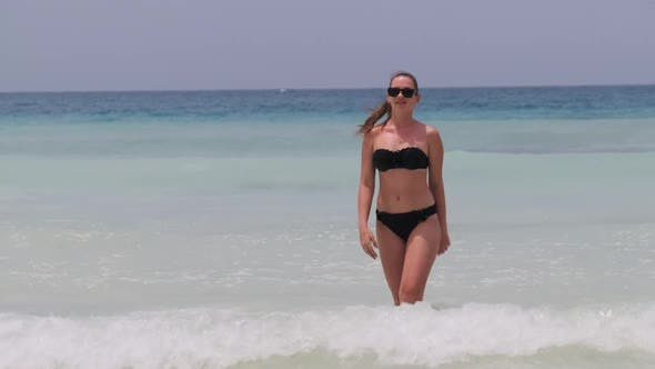 Young Woman in a Bikini Posing on Exotic Beach at the Turquoise Ocean Zanzibar