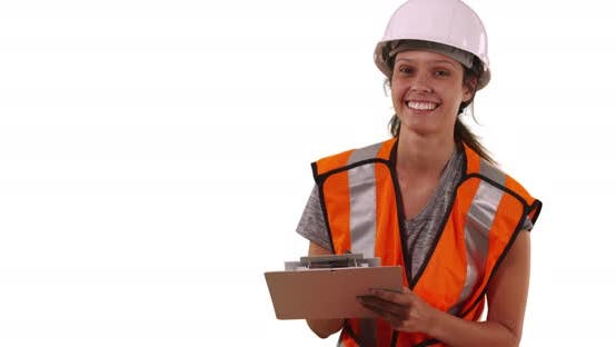 Thumbnail for Portrait of happy Female construction worker smiling at camera on white