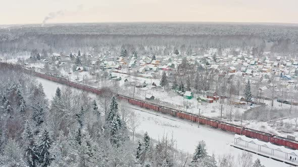 Thumbnail for Freight Train Moving Through Winter Forest