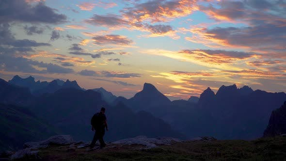 Thumbnail for A Man and a Woman Travel in the Mountains Early in the Morning