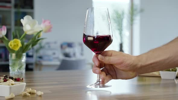 Thumbnail for Placing Glass Of Red Wine On Table