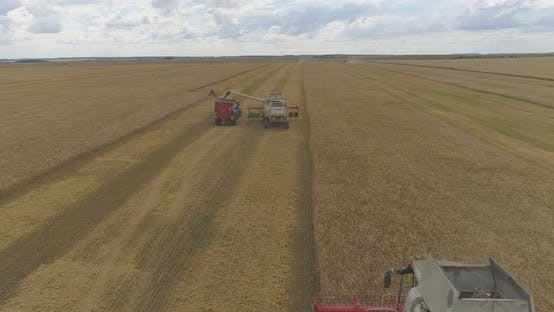 Thumbnail for Aerial of a combine unloading grain