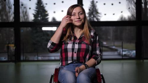 Portrait of Lovely Handicap Female in Wheelchair