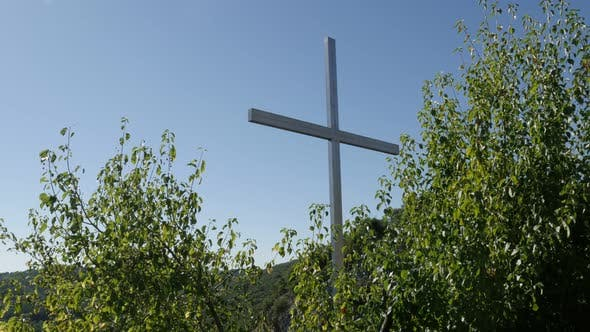 Thumbnail for Metallic religious symbol in the forest 3840X2160 UltraHD footage - Christian cross hidden  on cliff