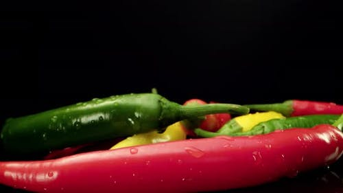 Spicy pepper close up wet drops