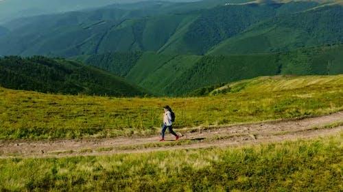 Aerial View Female Hiker Walking Path