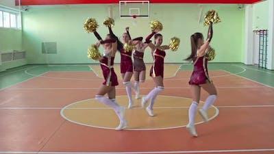 Girl Cheerleaders Dancing