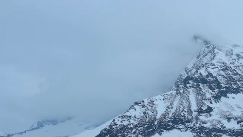 Snowy Mountain Peak Hidden in Thick Clouds, Weather Forecast, Storm Warning