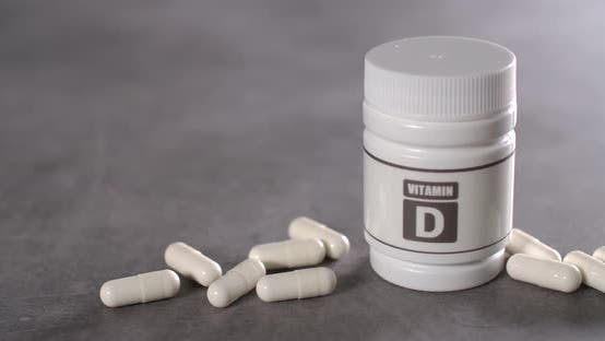 Thumbnail for Vitamin D Capsules near the Box