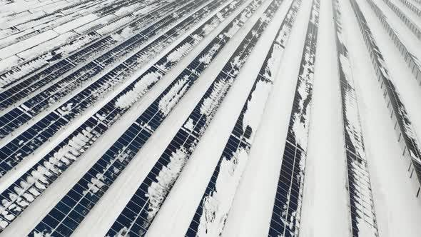 Thumbnail for Aerial View of a Snow on Solar Panels Farm in Winter