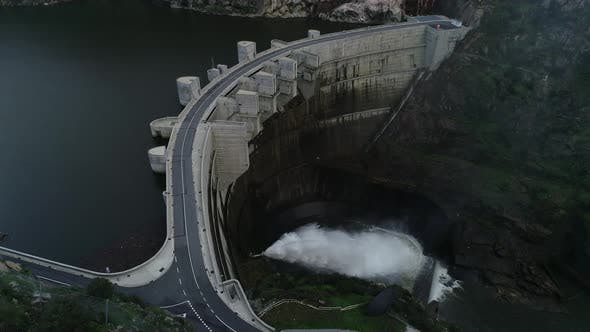 Thumbnail for Drone Camera Circles Over a Reservoir in Front of a Dam