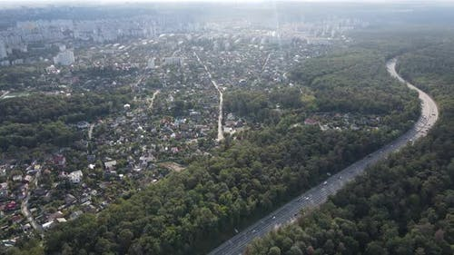 Megalopolis Next To the Forest: the Contact Between the Big City and Nature. Aerial View. Slow