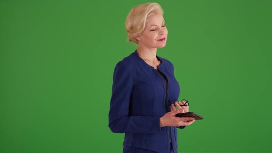 Female CEO removing glasses on green screen