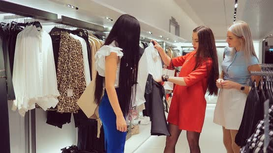 Girl Chooses Clothes From the Store and Helps with Her Friends