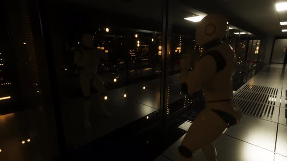 Thumbnail for The Dancing Robot in the Server Room Looks at Itself in Reflection. Data Servers Behind Glass Panels