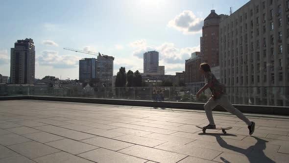 Thumbnail for Skillful Male Skater Riding Skateboard in City