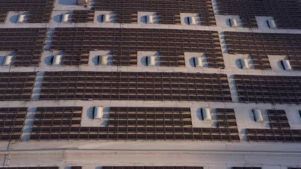 Thumbnail for Aerial shot of solar panels covers the roof of a large building