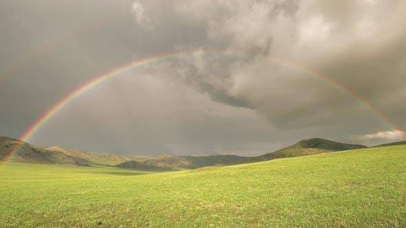 Colorful Rainbow in Vast Treeless Meadow