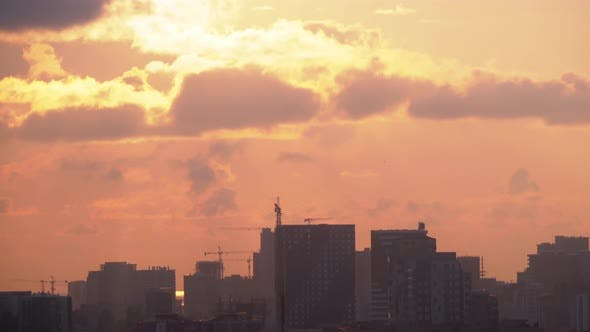 Thumbnail for Aerial View of Construction Sites, Cranes and Skyscrapers Silhouettes at Sunset