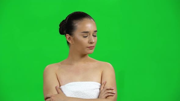 Cover Image for Girl in Towel Is Very Offended and Then Smiles on Green Screen at Studio