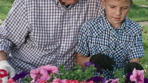 Thumbnail for Grandfather Teaching Boy How to Remove Weeds
