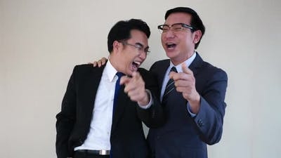 Two businessman laughing.