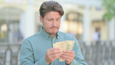 Portrait of Man Counting Dollars Outdoor