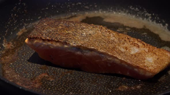 Thumbnail for Frying Salmon Fillet Is Turned on a Pan - Closeup