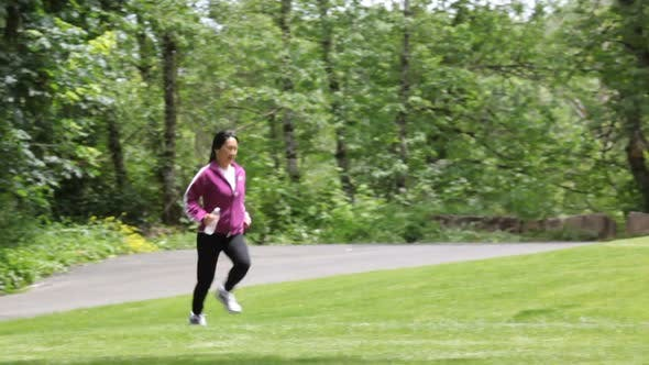 Thumbnail for Woman running at park