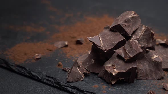 Thumbnail for Dark or Milk Organic Chocolate Pieces on Dark Concrete Background