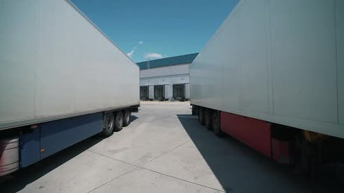 Trucks Are Parked for Unloading at the Logical Center