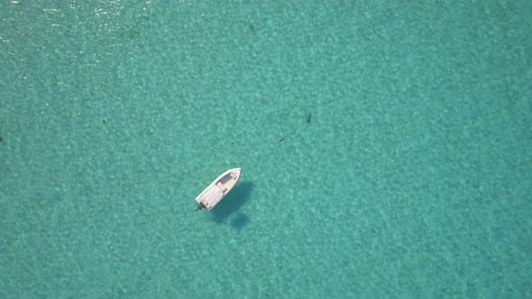 Thumbnail for Aerial drone view of a fishing motor boat in the Bahamas, Caribbean.
