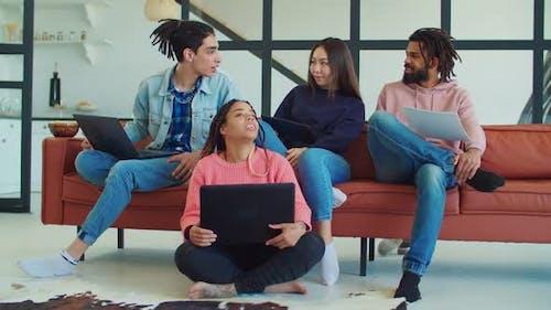 Multiethnic Students Working on University Project