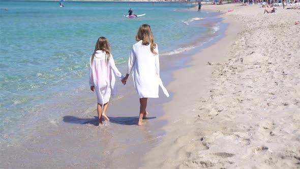 Thumbnail for Adorable Little Girls Having Fun on the Beach