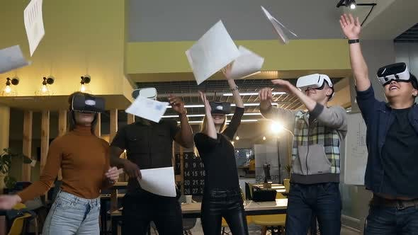 Thumbnail for Cheerful Office Workers Group in VR Virtual Glasses Throwing Paper Documents