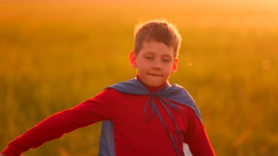 Thumbnail for Little Boy Plays and Dreams of a Super Hero at Sunset