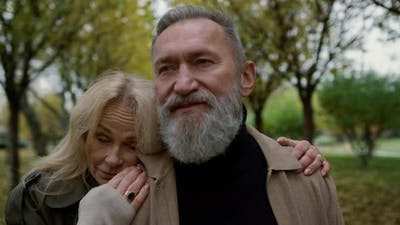 Portrait of Cheerful Elderly Couple Enjoying Each Other in Park