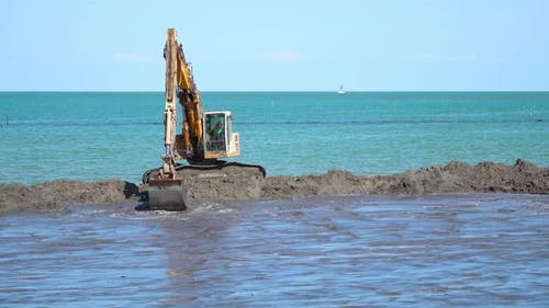 Sand is Being Dug Into the Beach