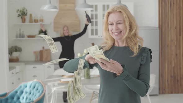 Thumbnail for Rich Mature Caucasian Woman Scattering Money and Smiling