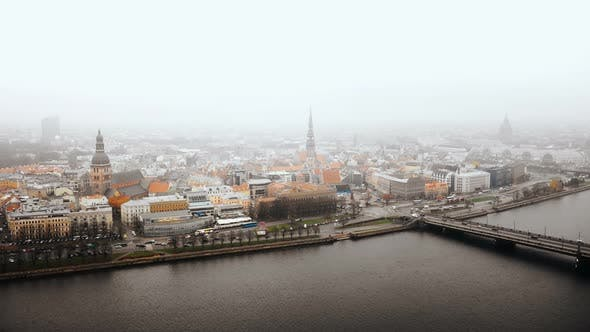 Thumbnail for Beautiful Aerial Cityscape Panorama of Riga Old Town, Busy Car Traffic and Daugava River Under Fog