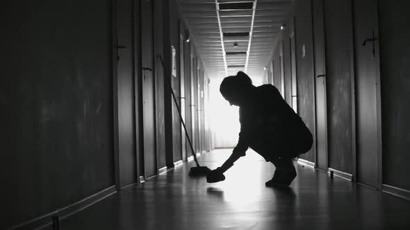 Cover Image for Tired Female Cleaner Scrubbing Floor