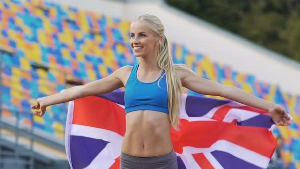 Thumbnail for Blond Athlete Holding Flag of Great Britain and Rejoicing Victory in Competition