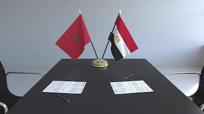 Flags of Morocco and Egypt and Papers